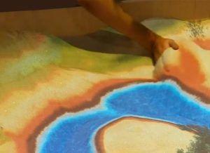 animation de mapping vidéo interactif sur du sable