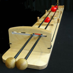 Le jeu traditionnel en bois du rolling-ball